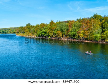 A scenic Autumn view of the Delaware River near Washington Crossing in Bucks County Pennsylvania. - stock photo