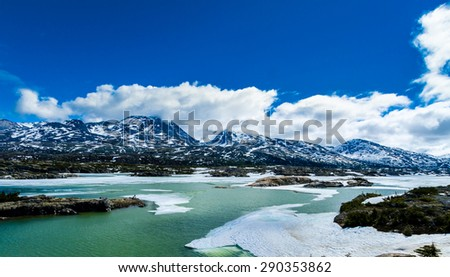 A scenic spot in Yukon Territory off Klondike Highway between Skagway in Alaska and Carcross in Canada. - stock photo