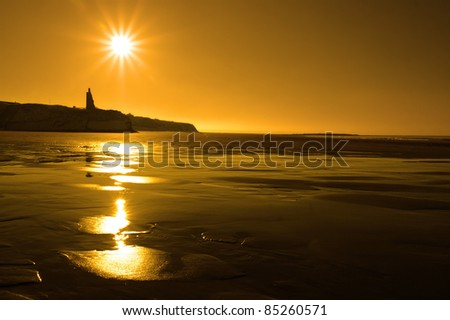 a scenic view of a castle on the irish coastline at ballybunion at sunset - stock photo