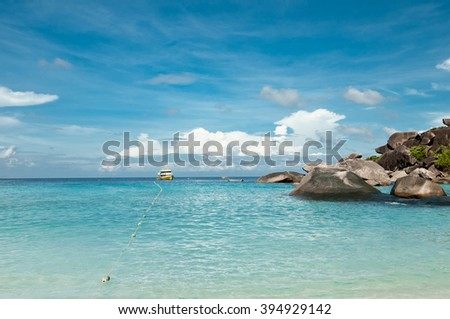 A scenic view on tropical beach with rocks, ocean, clouds and sky. Similan islands, Thailand, Phuket.