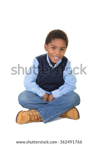 A school aged boy isolated on white
