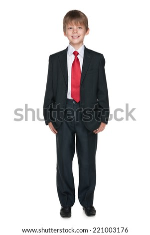 A school boy is standing on the white background