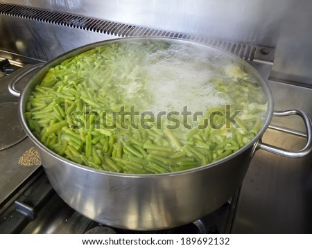 A school kitchen cooking green beans - stock photo