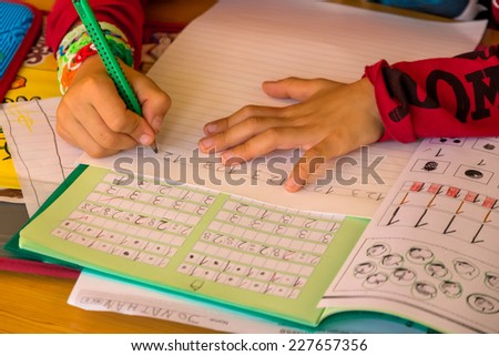 a schoolboy doing his homework. school assignments are made. - stock photo