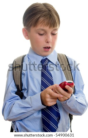 A schoolboy student using a mobile cell phone is sms or texting.  White background. - stock photo