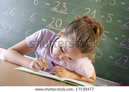 a schoolgirl in a classroom - stock photo