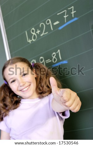 a schoolgirl in a classroom - stock photo