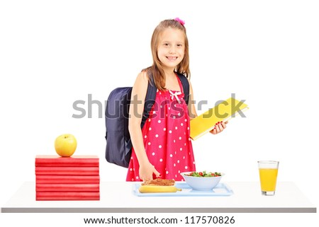 A schoolgirl with bag and book preparing for lunch isolated on white background