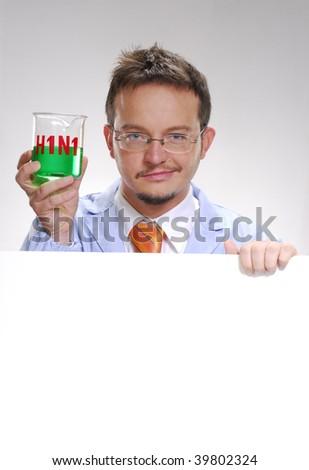 A scientist holding an experimental swine flu glass. A doctor holding an experimental glass. - stock photo