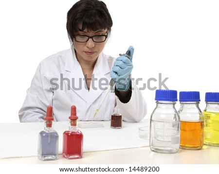 A scientist uses a pipette and spotting plate in laboratory research. - stock photo