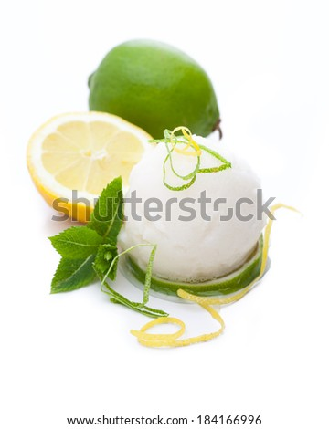 A scoop of lemon sorbet isolated on white background - stock photo