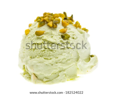 A scoop of pistachio ice cream topped with pistachio pieces isolated on white background - stock photo