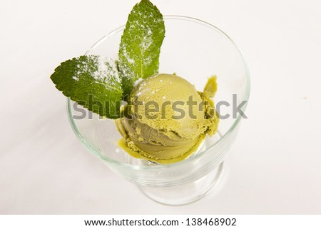 a Scoop of pistachio or mint ice cream with chocolate chips - stock photo