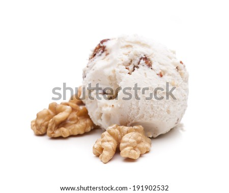 A scoop of walnut ice cream decorated with walnuts - stock photo