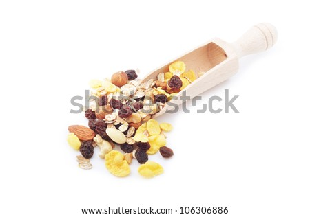 A scoop with mix of cereal, nuts and dried fruits - stock photo