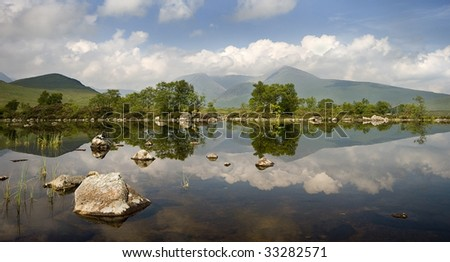 A scottish lake against mountains - stock photo