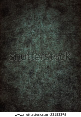 A scratched gray leather surface, suitable as a background texture. - stock photo