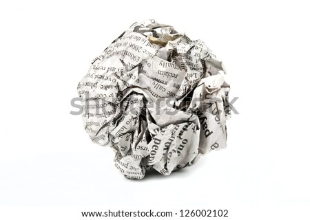 A screwed up piece of newspaper over a white background. - stock photo