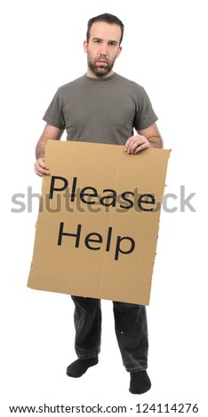 A scruffy looking guy holding a cardboard sign, isolated on a white background. - stock photo