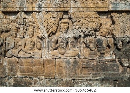 A sculpted relief panel at the Borobudur buddhist temple, a UNESCO World Heritage site in Central Java, Indonesia. - stock photo