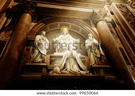 A sculpture in St. Peter's basilica Jesus, Saint Paul, Saint Peter and a pope - stock photo