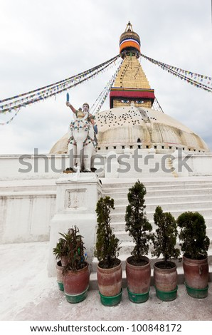 A sculpture of a warrior on the elephant protects the huge Boudhanath Stupa in Kathmandu, Nepal - stock photo