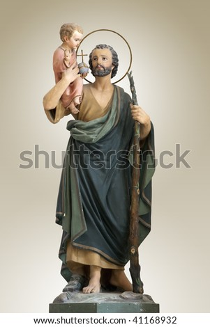A sculpture of Saint joseph with little jesus christ - Italy - stock photo