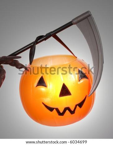 A Scythe And Pumpkin Under Spotlight