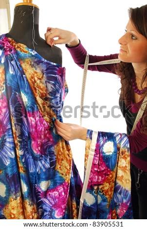A seamstress  prepares a dress high fashion - stock photo