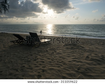 A seascape view during morning with a women  jogging in a distance in Terengganu,Malaysia
