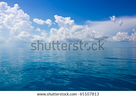 a seascape with beautiful clouds and turquoise ocean - stock photo
