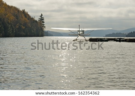 A seasplane on Lake Sacacomie during foliage season, Mauricie, Quebec, Canada - stock photo
