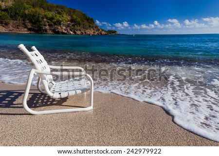 A seat on the waters edge - stock photo