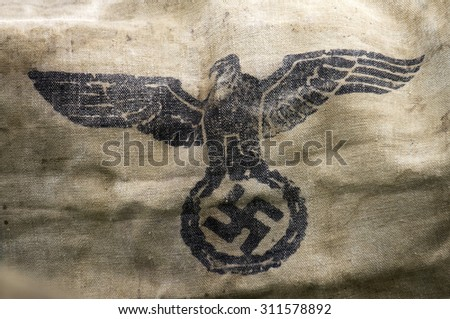 A second world war hessian bag, stamped with the Nazi Party eagle-and-swastika emblem. - stock photo