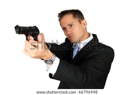 A Secret Agent taking aim with his pistol - stock photo