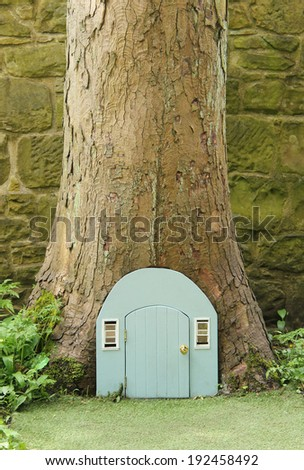 A Secret Doorway in a Woodland Tree. - stock photo