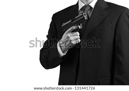 A secret spy agent against a white background. - stock photo