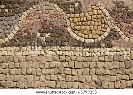 A section from an old mosaic floor in an ancient roman villa. - stock photo