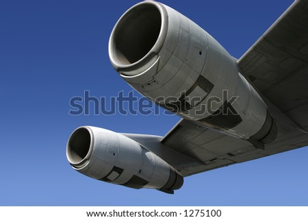 A section of a jumbo jet, viewed from below. - stock photo