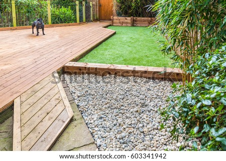 A Section Of A Residential Garden, Yard With Wooden Decking, Patio Over A  Fish