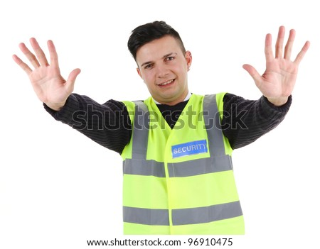 A security guard holding his hands out - stock photo