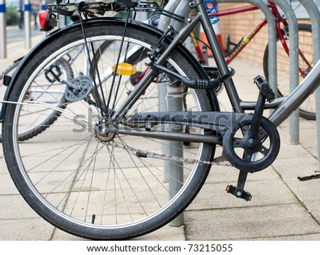 a security lock blocking bike wheel - stock photo