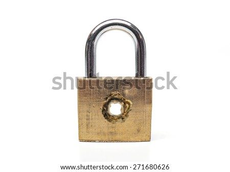 A security lock with a penetrated hole representing vulnerability on computer system / Bug on computer system - stock photo