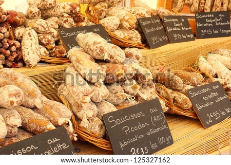 A selection of artisan sausages for sale in the outdoor market, Nyons, Provence, France. - stock photo