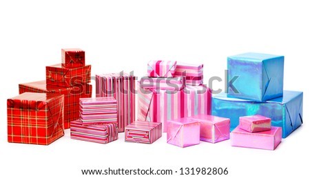 A selection of colorful presents on a white background - stock photo