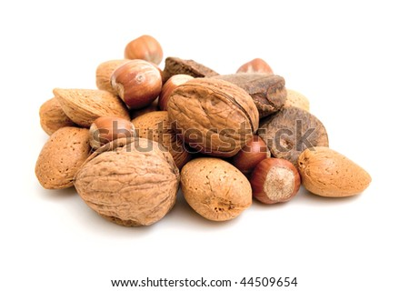 A Selection of nuts on a white background - stock photo