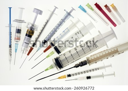 A selection of syringes and hypodermic needles used in medicine to give injections. - stock photo