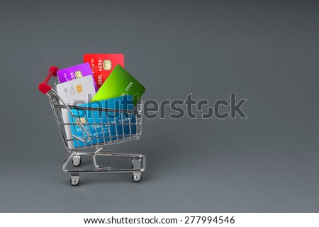 A selection off credit cards,bank cards and store cards in a shopping Trolley - stock photo