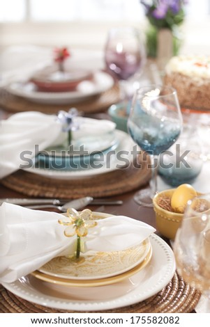 A selective focus view of Spring or Easter dining place settings in multiple colors - stock photo