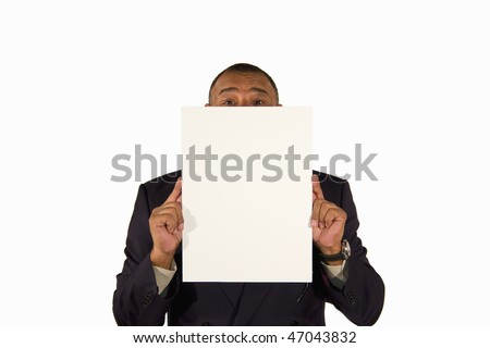 a senior African-American businessman holding a picture board with copy space in front of his face, isolated on white background - stock photo